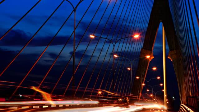 traffic car on bridge at sunset timelapse. video