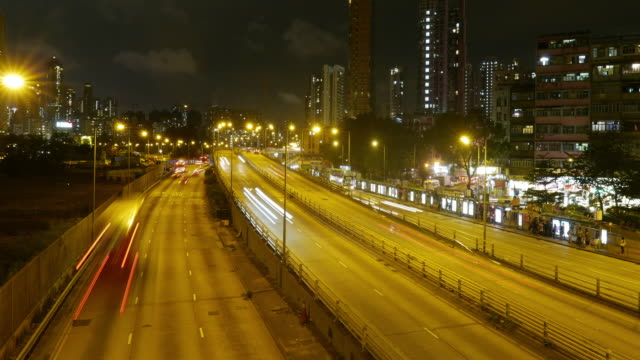 Traffic in downtown Hong Kong at night, panning right time lapse. video
