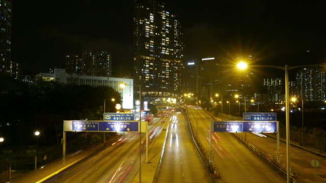 Traffic in downtown Hong Kong at night, tilt down time lapse. video