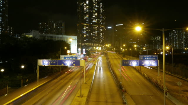 Traffic in downtown Hong Kong at night, zoom out time lapse. video