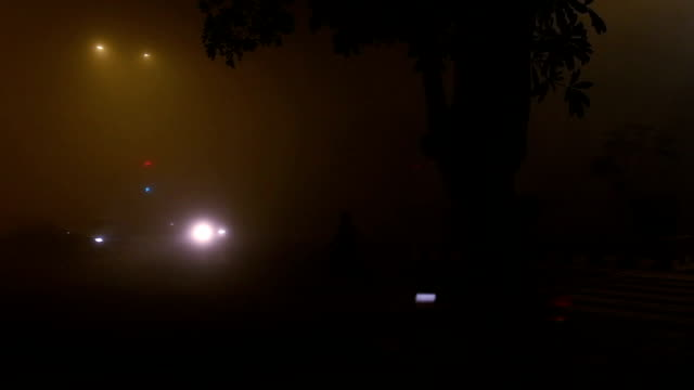 Traffic in the City During Foggy Night Time Lapse video