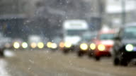 traffic in the snow, snowflake, car traffic on slippery road video