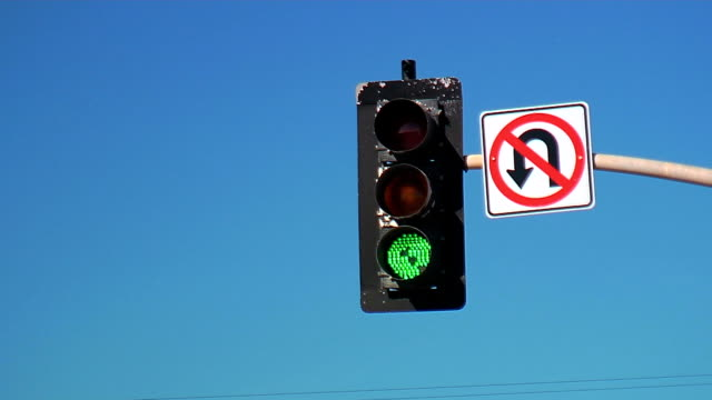 traffic light changes in front of blue sky video