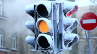 Traffic light covered with frost on a frosty winter day. video