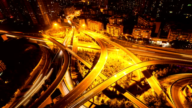 traffic light trail on road intersection of modern city chongqing,at night, timelapse. video