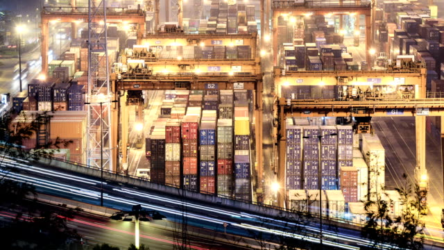 traffic light trails and busy container harbor hong kong at night, timelapse. video