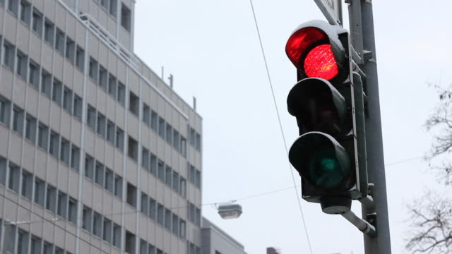 Traffic lights turning green in winter Germany video