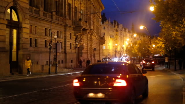 Traffic near National theatre in Prague,by night video