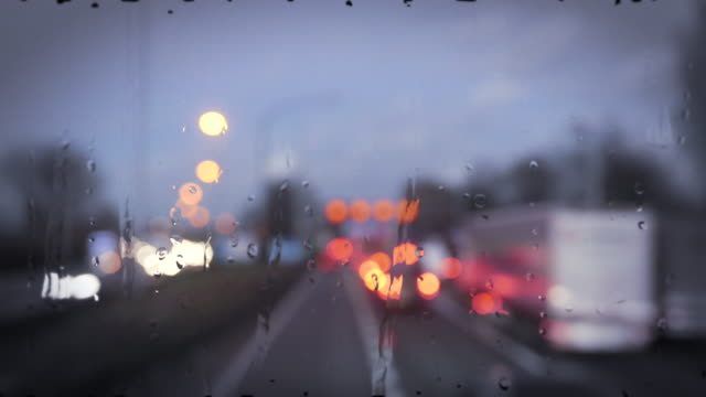 Traffic on a highway, seen through rainy window video