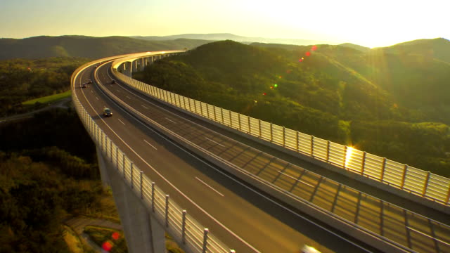Traffic On A Viaduct At Sunset video