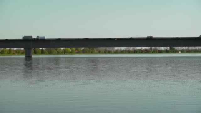 PAN Traffic On Highway Bridge Over Big River (4K/UHD) video