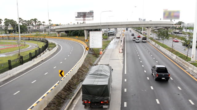 traffic on multiple lane highway in Thailand video