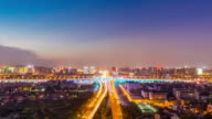 traffic on road, cityscape and skyline in hangzhou at twilight. timelapse 4k video