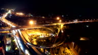 traffic on road junction in hangzhou at night. timelapse video