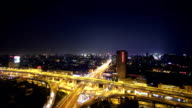 traffic on road junction in hangzhou at night. video