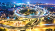 traffic on road junction in shanghai at night. timelapse 4k video