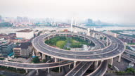 traffic on road junction in shanghai. timelapse 4k video