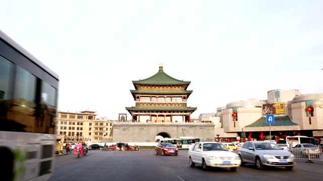 traffic on road near famous old architecture in Xi'an video