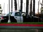 Traffic Passes Stopped Police Car video