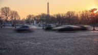 Traffic passes  with the Eiffel Tower in sunset video