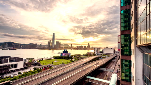 traffic through modern city with sunrise,time lapse video