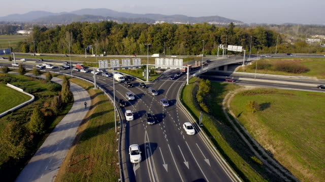 AERIAL: Traffic waiting for a green light at roundabout video