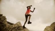 SLO MO trail runner jumping from the rock video