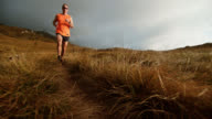 SLO MO trail runner running on the mountain plateau video