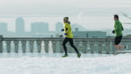 Trail runners training in the city video