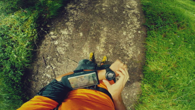 POV Trail running in the forest: checking smart watch video