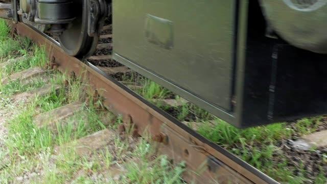 Train coach carriage wheels on rails runway video