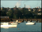Train Disturbs Quiet, Crosses Bridge Over Harbor, Harbour, Bay video