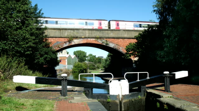 Train on a bridge going over the Grand Union Canal. video