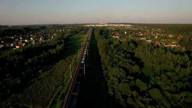 Train running in the village, aerial view video
