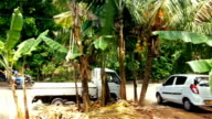 Train window view on poor suburbs in Sri Lanka, many tuk tuks parked on street video
