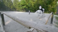 DS Trainer holding the longe line as rider canters on a horse video