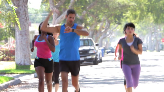 Trainer Leading Group Of Women On Run video