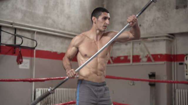 Training hard with Olympic barbell video