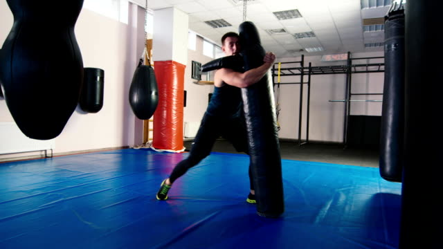 Training in freestyle wrestling. Man training with dummy video