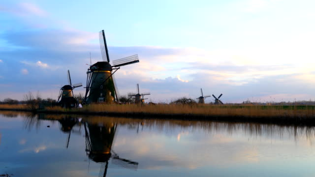 Tranquil scene of windmills at dusk video