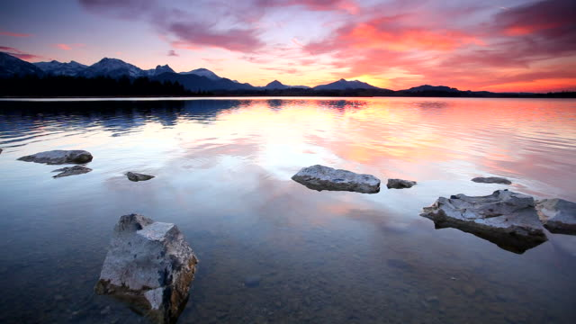tranquil sunset at lake bannwaldsee in bavaria - germany video