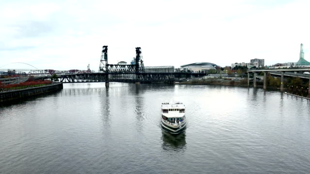 tranquil water with yacht and steel bridge in portland video
