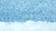 transparent christmas baubles on blue defocused background video