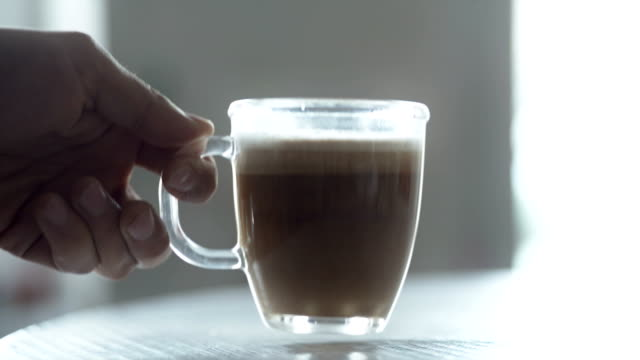 Transparent full cup of coffee latte video