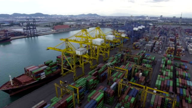 Transportation dock with container ship and crane, Aerial view video