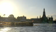 transportation on river at Wat Arun, Bangkok, Thailand video