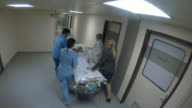 POV Child on stretcher being pushed by medical staff video