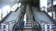 travel abstract, asian traveller girl with backpack on the public transportation escalator video