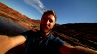 Travel man hiking takes selfie portrait video
