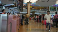 Traveler Crowd at Airport Check In Counter Hall Changi Airport video
